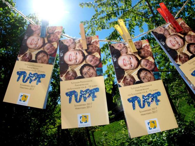 Bild der TUPF-Flyer, die an einer Wäscheleine hängen