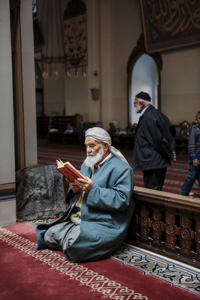 _SM16461, Turkey, 10/2011, TURKEY-10212. A man reads inside a mosque.CAPTION: Man Reads in Mosque. Turkey, 2011. Retouched_Sonny Fabbri 12/23/2015